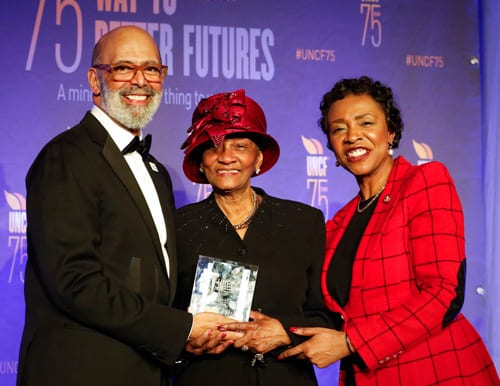 Dr. Michael L. Lomax with Dr. Una S. T. Clarke, receiving her Shirley Chisholm Award alongside her daughter, Congresswoman Yvette Clarke.