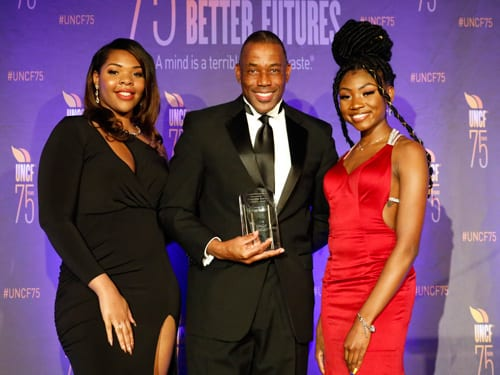 UNCF-Delta Air Lines Scholar Tanya White; and Jasmine Brown with Henry Kuykendall when he accepted the Corporate Partner Award for Delta Air Lines