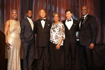 Honorees Cornell andWendaMoore, with mayors and Michael Cox