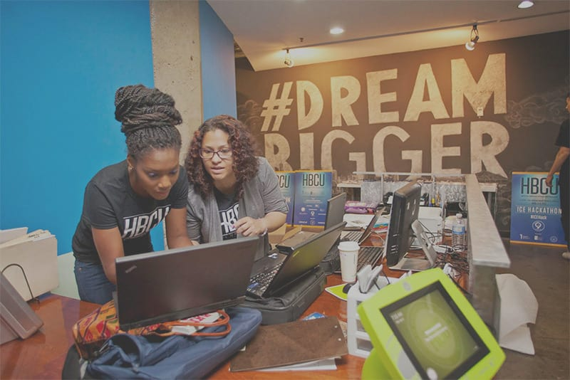 2 female students participating in UNCF HBCU Innovation Summit Hackathon