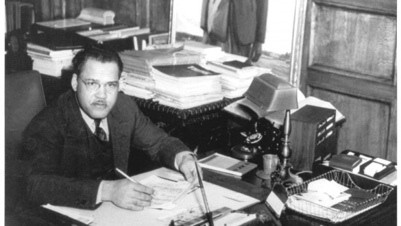 Frederick D. Patterson sitting at desk