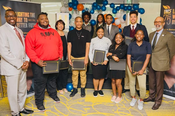 UNCF President Dr. Michael Lomax, Senior Vice President Scholarships and Professional Development Programs Larry Griffith and UNCF scholarship recipients