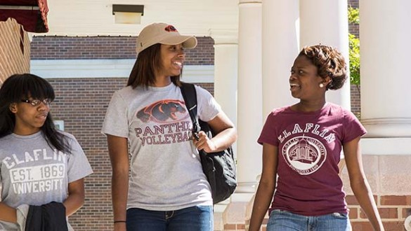 3 female students walking at Claflin University