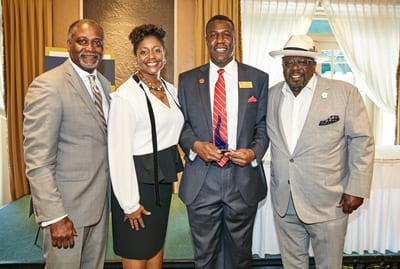 UNCF's Michael Cox, Sharita Kyle-Wilson (Cedric's sister), Keeper of the Flame honoree Dr. Art McCoy, superintendent, Jennings School District; and Cedric the Entertainer