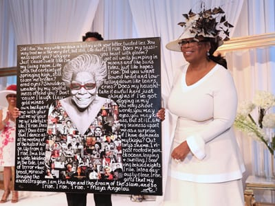 Winfrey with commemorative plaque of Dr. Maya Angelou