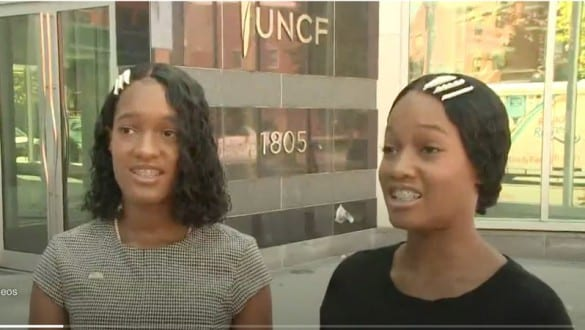 Two girls standing outside of UNCF office