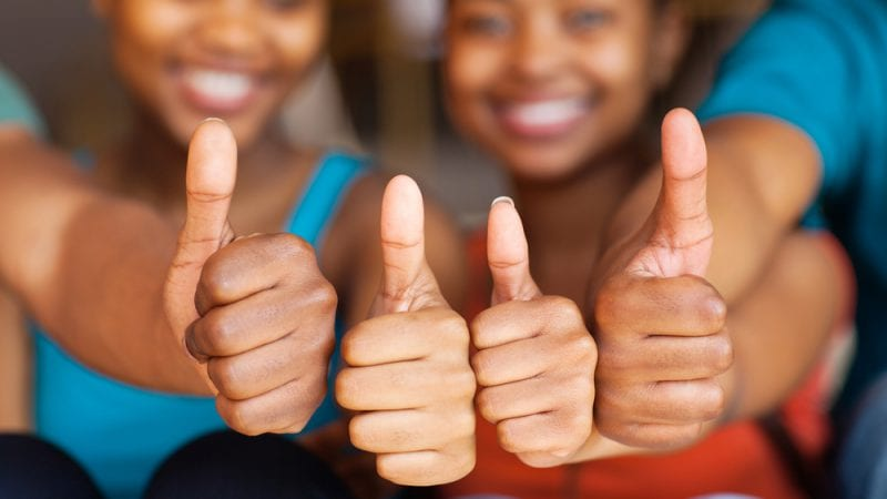 4 students with thumbs up